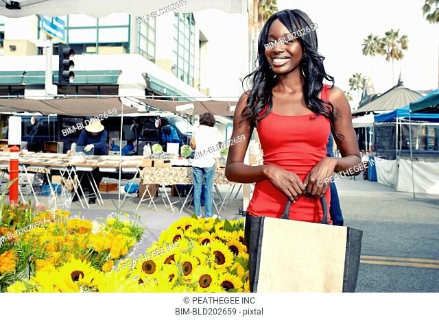 African American woman buying flowers