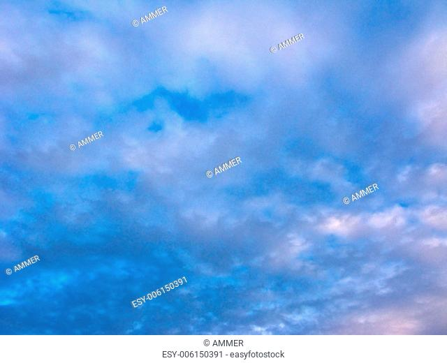 Cloudscape, blue sky with fluffy clouds