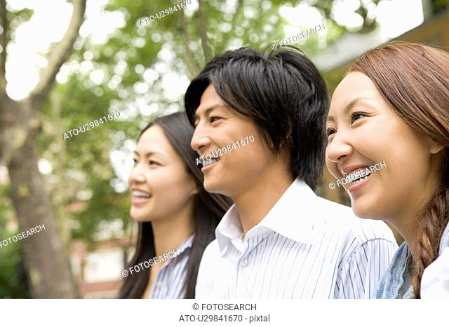 Man and women smiling and standing together