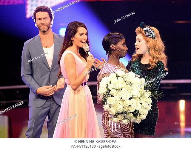 Jury member Howard Donald (L), TV host Johanna Klum (2-L) and jury member Palina Rojinski (R) congretulate jury member Nikeata Thompson on her birthday during...