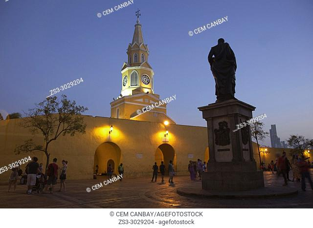 View to the cathedral with clock tower by night in the historic center with the statue of Pedro De Heredia in the foreground, Cartagena de Indias, Bolivar