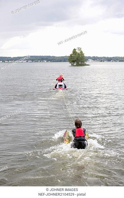 Jet ski pulling water skier
