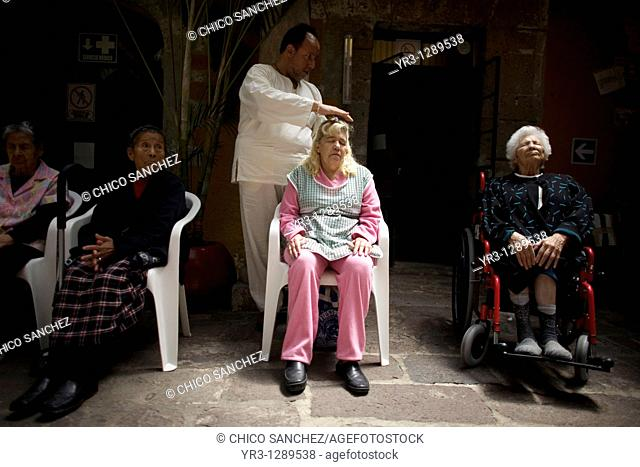 A woman receives Reiki in Mexico City, November 30, 2010  Reiki is a spiritual practice developed in 1922 by Japanese Buddhist Mikao Usui  It uses a technique...
