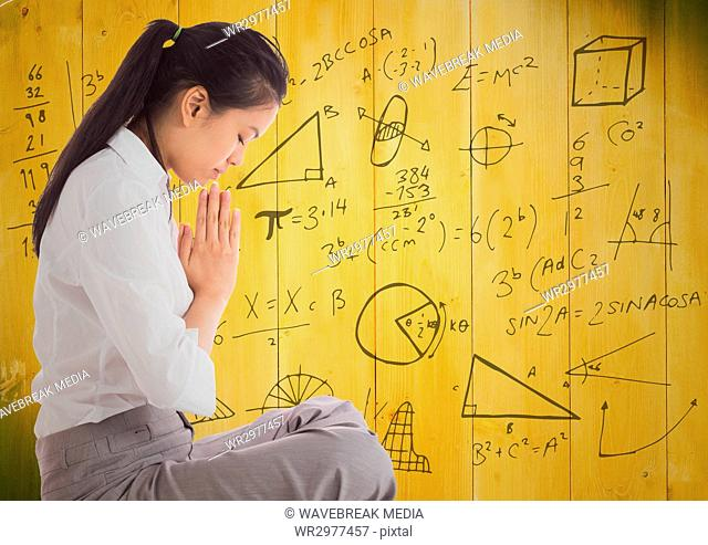 Business woman meditating against 3D yellow wood panel and math graphic