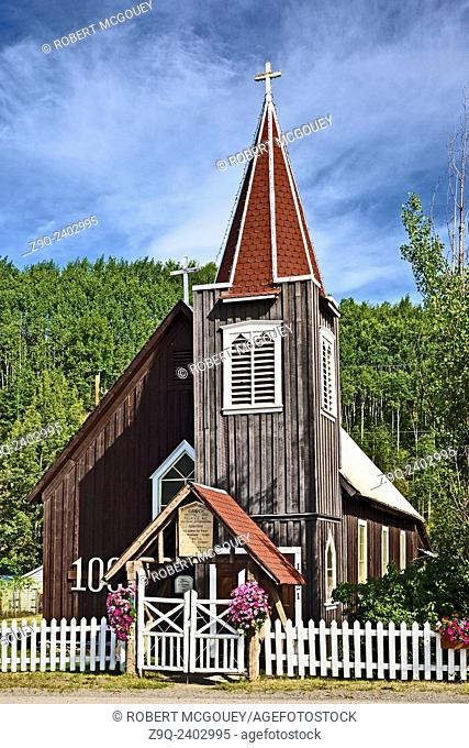 A vertical summer landscape image of a 100 year old church located in Telkwa B.C.Canada
