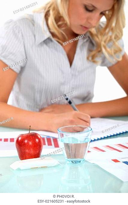 Female accountant going over records