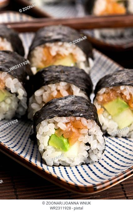 Sushi - Salmon rolls served on a plate
