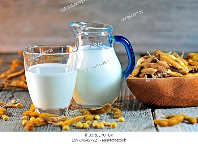 Glass of soybean milk on a wooden table