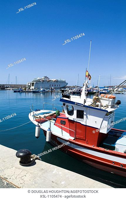 MORROJABLE FUERTEVENTURA Traditional Fuerteventuran fishing boat in harbour Naviera Armas ferry