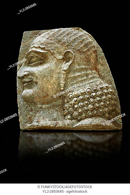 Stone relief sculptured panel of a Servant. From the facade of the throne room, Inv AO 22196 from Dur Sharrukin the palace of Assyrian king Sargon II at...