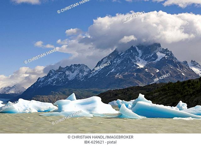 Icebergs and mountain peaks of the Torres del Paine Grande, seen from the Lago Grey, Torres del Paine National Park, Patagonia, Chile, South America