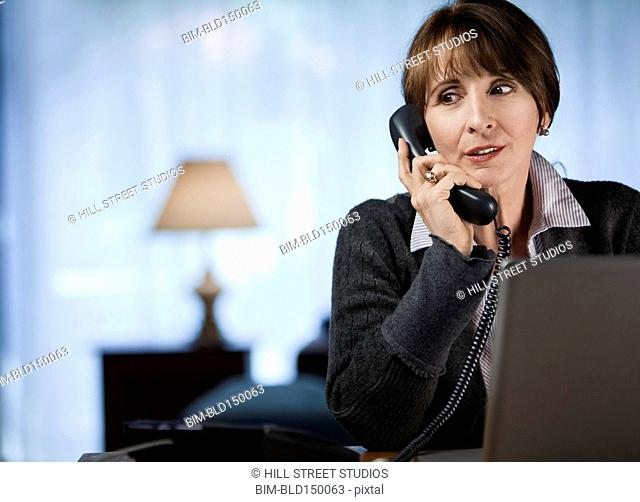 Caucasian woman talking on telephone
