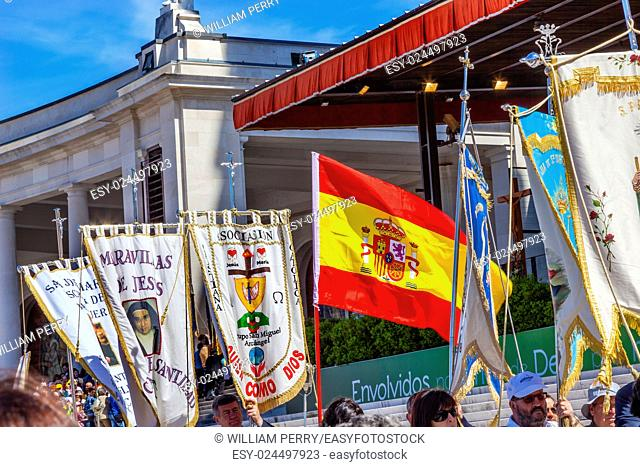 Believers Banners Spanish Flag May 13 Apparation Day Basilica of Lady of Rosary Bell Tower Fatima Portugal. Church created on site where three Portuguese...