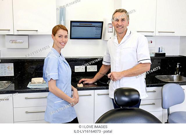 A dentist and dental nurse in a dental surgery
