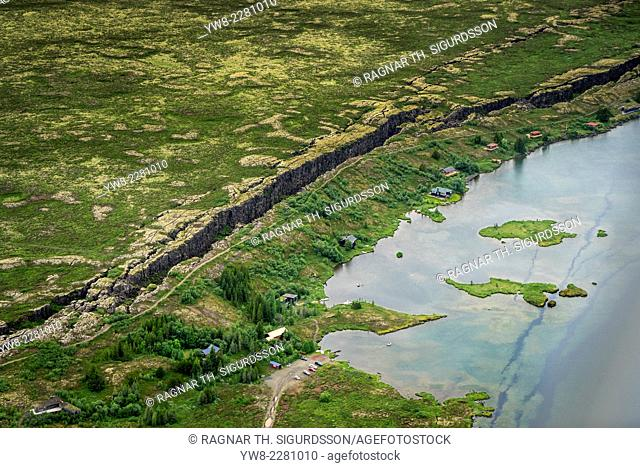 Aerial view of the Mid-Atlantic Ridge, Almannagja Fault, Thingvellir National Park, Iceland. Almannagja is a large fault located within the active fissure of...