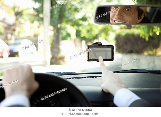 Driver using GPS for navigation assistance