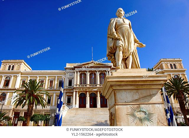 Statue of Andreas Miaoulis, celebrated admiral of the Greek War of Independence, and the Neo Classic City Hall of Ermoupolis, Miaoulis Square, Syros  S