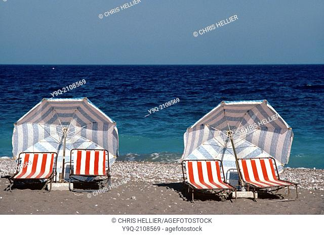 Deckchairs & Umbrellas or Parasols on Deserted Beach Rhodes Greece