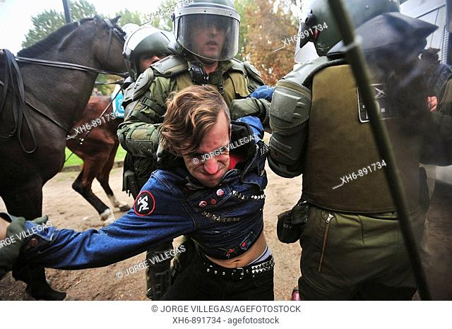 Santiago Chile May 13 2009 Chilean police assaulted a student for shouting slogans and demonstrations in protest against the new education law under discussion...