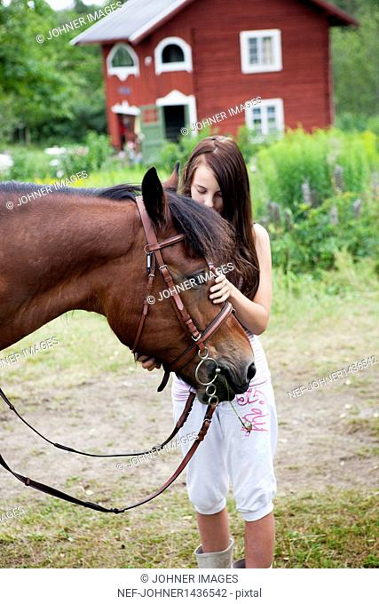 Outdoor portrait of girl with her horse