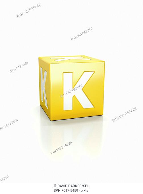Yellow cube with letter K