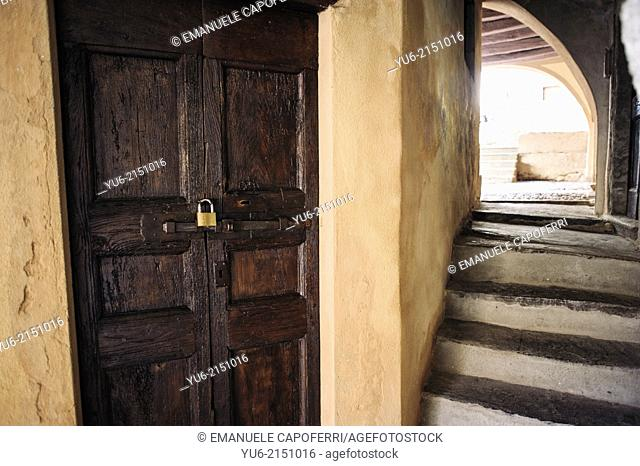 Old stairs with ancient wood door, the village of Orta, Lake Orta, Piedmont, Italy
