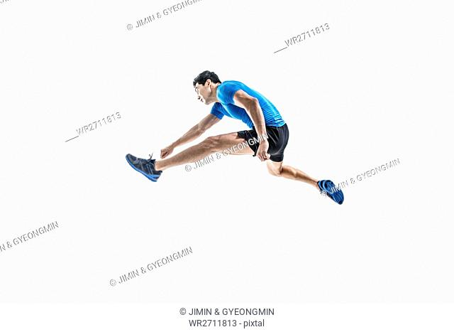 Male athlete jumping