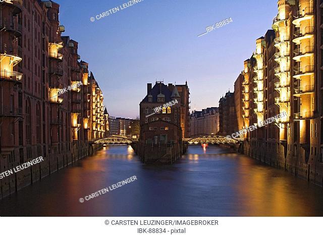 Wasserschloss, Water Castle in the old warehouse district Speicherstadt in Hamburg at night, Germany
