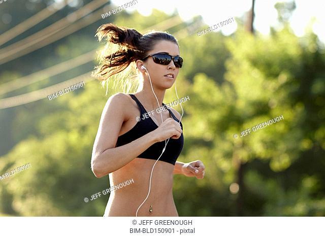 Caucasian woman running outdoors