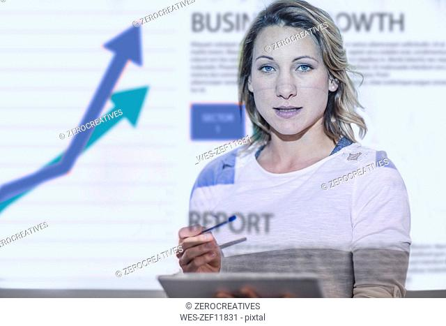 Portrait of businesswoman with chart in the background