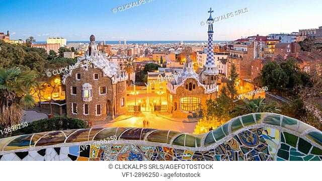 Barcelona, Catalonia, Spain, Southern Europe. Antonie Gaudi's architecture in Park Guell at dusk