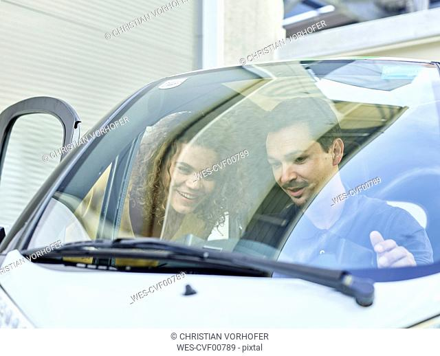 Smiling couple with electric bubble car