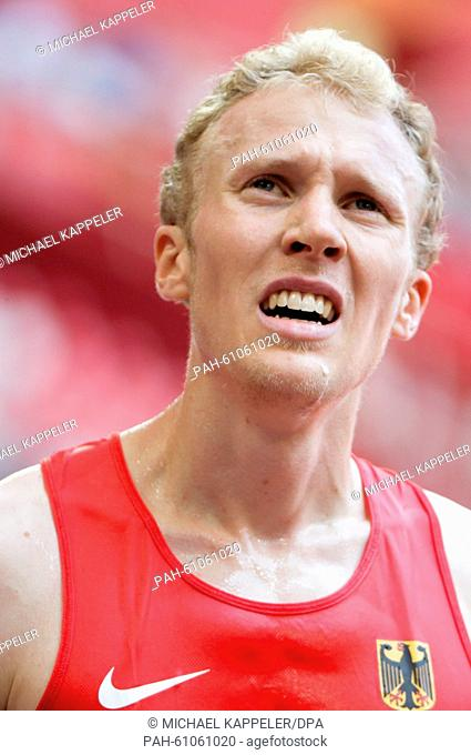Germany's Richard Ringer looks on after the Men's 5000 m Round 1 on the 15th International Association of Athletics Federations (IAAF) Athletics World...