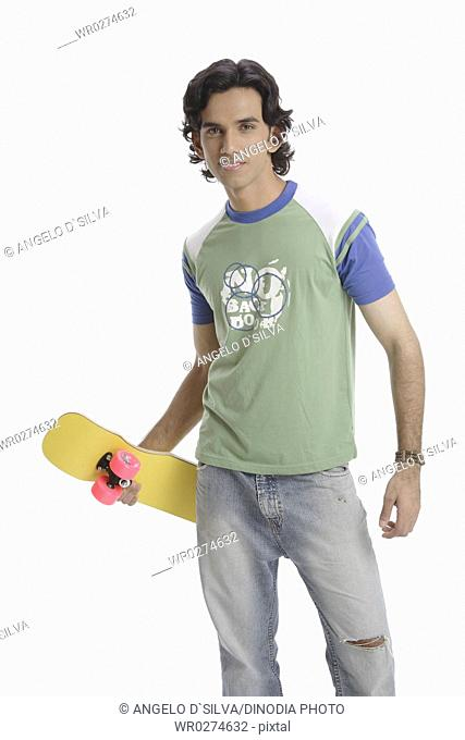 Teenage boy standing with skate board in hand MR 687T