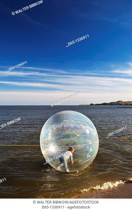 Lithuania, Western Lithuania, Curonian Spit, Nida, kids in waterball, NR