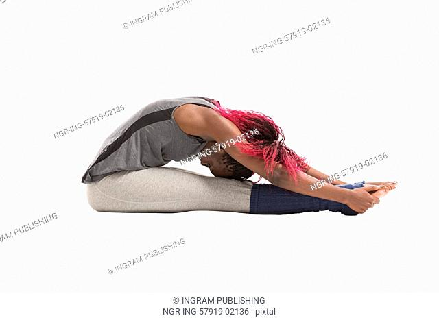 Young african woman doing a stretching exercise isolated on white background