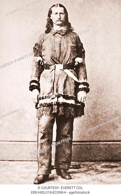 Wild Bill Hickok portrait in buckskins with a large knife tucked into his belt. Ca. 1869