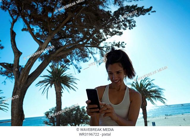 Female video blogger taking selfie with mobile phone
