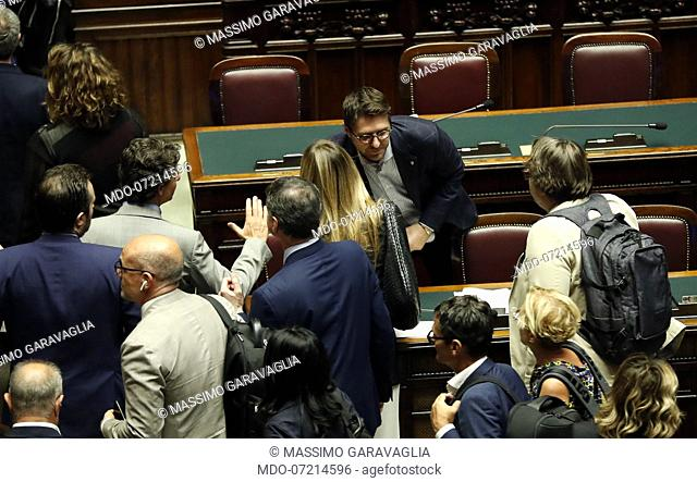Nicola Molteni and Massimo Garavaglia rejoice after the final vote during the vote for the security decree bis in the Chamber of Deputies