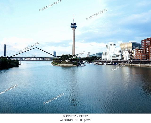 Germany, Duesseldorf, view to Rhine Tower and New Zollhof with Media Harbour in the foreground