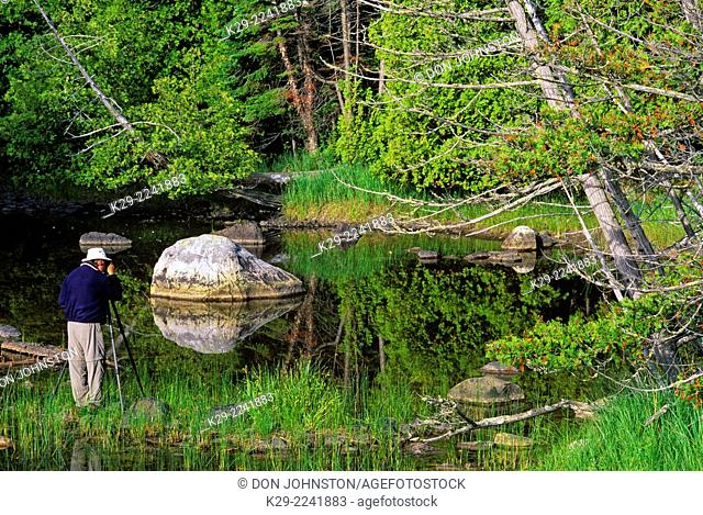 Outdoor Photography- Photographer with tripod near Lake Superior , Batchawana Bay, Ontario, Canada