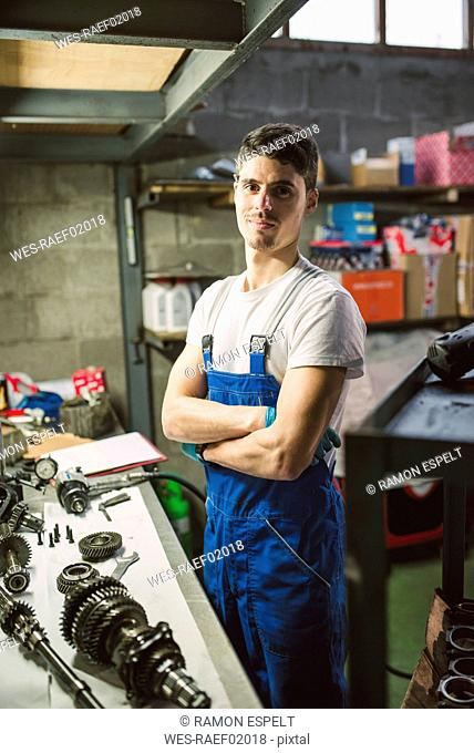 Portrait of confident mechanic in his workshop