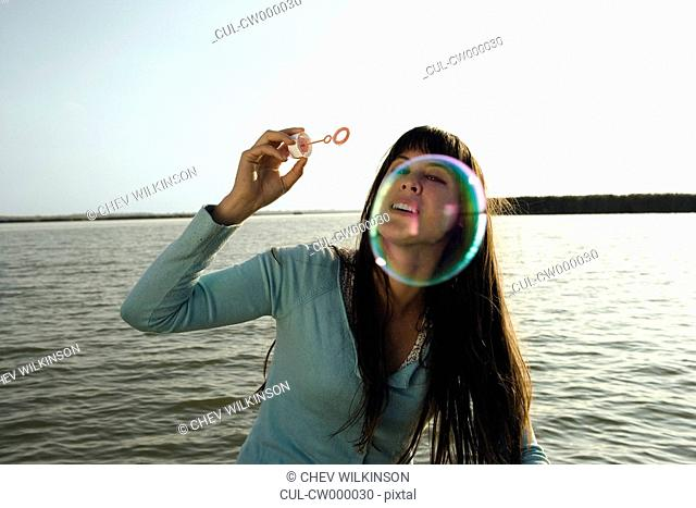 Woman blowing bubble