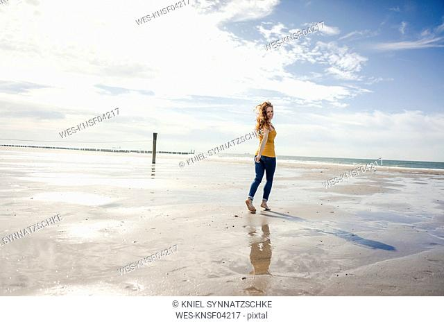 Woman relaxing at the beach, strolling around