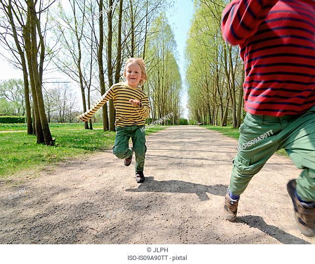Children running on path in park