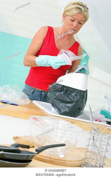 ELDERLY PERSON DOING HOUSEWORK<BR>Model
