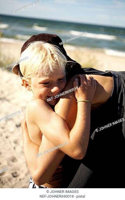 Mother and son on a sunny beach, Sweden
