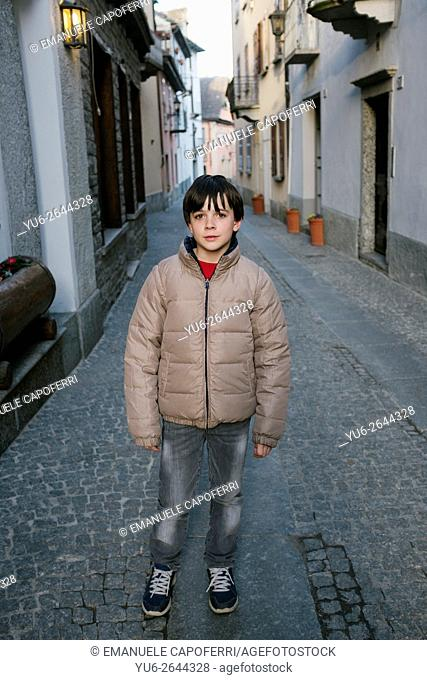 Portrait of little boy in the streets of Santa Maria Maggiore, Valle Vigezzo, Piedmont, Italy