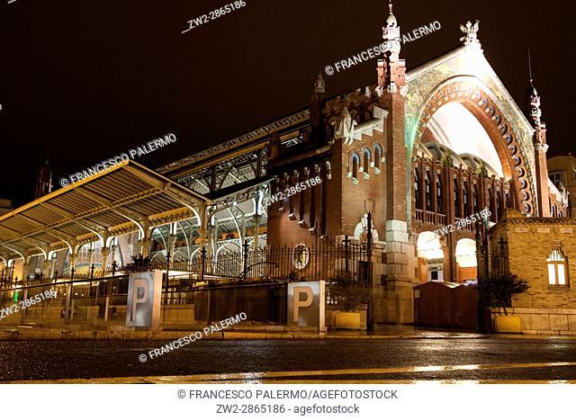 Facade of the Mercado Colon market at night. Valencia, Spain