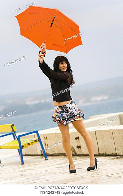Playing with a Red umbrella